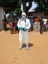 While on assignment in Liberia, John Moore wore protective gear to protect himself from getting the Ebola virus.