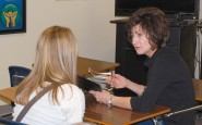 UIL Sponsor Excellence Award winner Kelly Martin of Stamford High School works with a student during class.