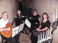 Music associate Patty Esfandari (back right) poses with her ensemble, Heralds and MInstrels. Patty has played with the ensemble for 20 years.