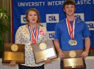 Lindale High school student Jessie Elliot and White Oak High School student Austin Jordan display their medals and plaques after the journalism awards ceremony at the Academic State Meet. Both students were in all four journalism contests, and both students medaled in each of the four contests.