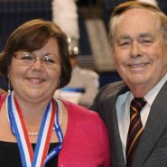 Former Music Director Richard Floyd (pictured left) and current Music Director Dr. Brad Kent honored Patty Esfandiari at the 2014 State Marching Band Contest at the Alamodome.